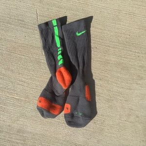 Gray/green/red Nike socks